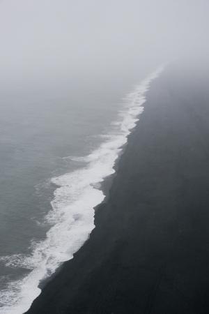 Plage de sable (sandur) vue de Dyrholaey, Islande